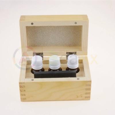 Scatola legno con pietra paragone 75x50x6 mm e flaconi vetro 3 pz 130x76x80 mm