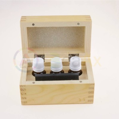 Wooden box with tools for metal test with natural stone and 3 glass bottles